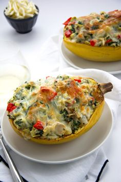 Stuffed spaghetti squash filled with a lightened up version of a favorite dip - spinach and artichoke! A super simple, yet healthy dinner that perfect any night of the week! #stuffedspaghettisquash #paleo #glutenfree