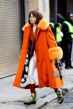Outfit Recipe | Bright orange fur lined coat layers over a dark rusty colored blazer and white silk dress. Green faux snake skin boots and Marsala tights