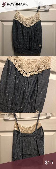 Abercrombie Kids Small Polka Dot Top New with tags. Super cute Abercrombie Kids top. May be worn as a crop top for smaller women. Blue with white polka dots and crocheted top. Size small. Abercrombie & Fitch Tops Tank Tops