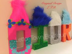 **Price Shown is per Letter** Not The Set** Trolls Letters Trolls Party Trolls Birthday Dreamworks Trolls Movie Trolls Centerpieces Trolls Cake Table Trolls Table Favors Trolls Theme Adorable Dreamworks Trolls Letters! We can also design any name, number characters and color of your choice. :) Letters measure 8 inches tall Legal Notice: Not a licensed item. All characters used have a maintained copyright. All copyrights and trademarks of the character images used belong to their respect...