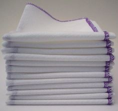 One Dozen Reusable Unpaper Towels with a Purple Border   Many uses! You can never have too much purple, in my opinion, and the pretty purple