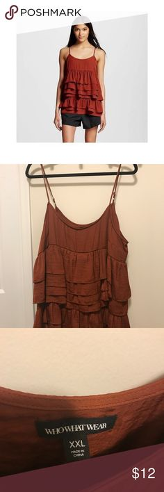 Ruffle tank NWOT rust / burnt orange ruffle tank. Very flattering around mid section and hides imperfections well. Silky material & can dress up or down! target Tops Tank Tops