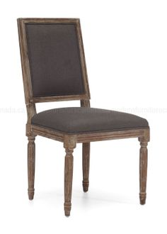 Our reproductions of vintage French dining chairs display the elegant restraint emblematic of neoclassicism. Defined by linear form and tapering fluted columnar legs a, the chairs have been updated in hand-carved elm with a soft, weathered finish. Fabric is charcoal grey linen.