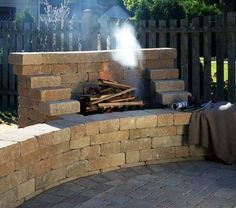 Alternative to fire pit, an open fire place/braai against the wall