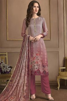 This Dusty Pink and Grey Georgette Trouser Suit Which will surely tell them that the diamonds aren't the only beautiful thing which they have seen. Along with Santoon Trouser in Mauve pink Color with Printed Georgette Dupatta.