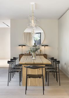 Nathalie Priem Photography  Elegant and contemporary dining area with rustic wooden table, and brass, glass chandelier in Notting Hill home. Designed by Echlin.