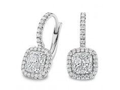 Halo Dangling Diamond Earrings - cushion cut diamonds surrounded by a white diamond pavé halo on 18-karat white gold earrings.