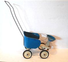 The stroller works great although the tires show. With cream centers, rubber wheels. Signs of wear with cracks on the rubber covering the tires. Doll Furniture, Blue Cream, Ohio, Baby Strollers, 1950s, Dolls, Metal, Cute, Vintage
