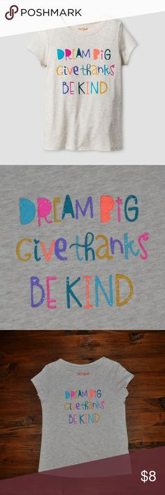 "New CAT & JACK Short-Sleeve Kindness Graphic Tee She can carry a positive message with her everywhere in this Short-Sleeve Kindness Graphic Tee from Cat and Jack. In oatmeal heather, this graphic T-shirt features the words ""Dream Big, Give Thanks, Be Kind"" across the front in colorful lettering. She can pair with jeans or a skater skirt for a look that's both casual and confident.   size 18M condition: new without tags color: oatmeal heather  @cjrose25  bundle your likes for a private…"