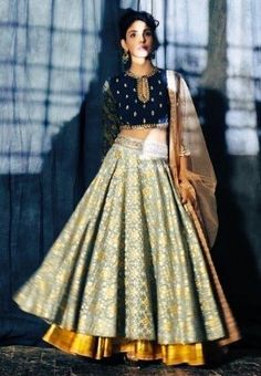 A stunning lehenga in a rare colour combination by Anju Modi Clothing. Definitely something to get your hands on. Choli Designs, Lehenga Designs, Blouse Designs, Dress Designs, Western Dresses, Indian Dresses, Indian Outfits, Anarkali, Churidar