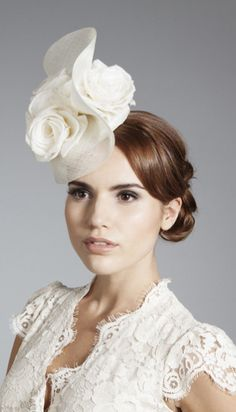 Gina Foster Millinery, Bridal 2014 - Ivory straw button with matching straw swirl trim and a cluster or ivory silk roses. Secured with an elastic that sits under the hair.