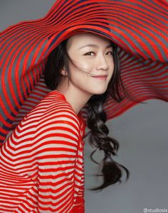 Tang Wei wearing a #GiorgioArmani striped top and oversized hat
