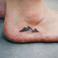 Show off your love of the outdoors with this mountaintop ankle tattoo.