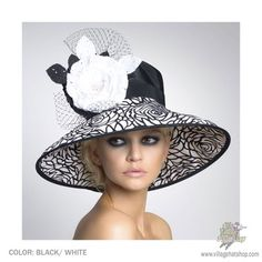 The Chelsea is a widebrim derby hat made of black and white taffeta with burnout prints. It's adorned with two strong cotton flowers and a French veil making this the perfect women's dress hat for the season.