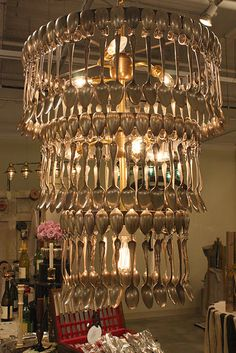 silverware chandelier - this would take an awful lot of spoons but I think we would have a blast making one of these