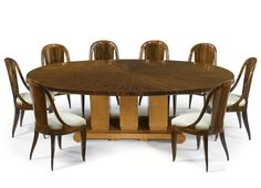 "Émile-Jacques Ruhlmann DINING TABLE, MODEL 1314 NR AND EIGHT ""CANNELÉE"" DINING CHAIRS, MODEL 77 AR/88 NR underside of top branded twice Ruhlmann and with the Warhol Collection auction paper label base branded with the atelier B mark, ébène de macassar and amboyna, circa 1930."