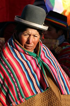 Bolivia fabric. The women are amazing with their hats - apparently depending on which why you tip it you let people know if you are available.