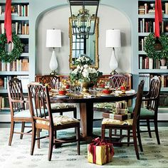 Built-In Bookshelves | The repetitive shape of books on a shelf can act as a pattern in your dining room. | SouthernLiving.com