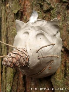 clay sculpture outdoors on the trees.. from a fun English site, nurturestore.uk