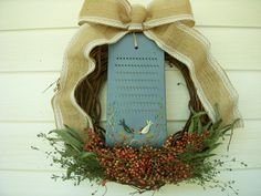 Kitchen herb wreath with an antique tole painted grater in a rooster and hen theme with a burlap bow