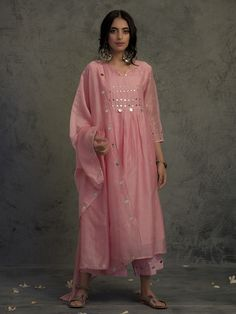 Chanderi kurta set in rose pink hue with mirror work on yoke and sleeves. Look for the Rose Pink Mirror Work Suit Set-Set Of Three. Kurta Designs Women, Kurti Neck Designs, Kurti Designs Party Wear, Pakistani Fashion Casual, Pakistani Dress Design, Indian Fashion, Pakistani Clothing, Gothic Fashion, Women's Fashion