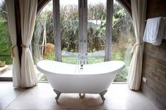 insert this view, that tub, and those curtains into my bathroom and i will be very pelased
