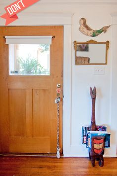 """""""DON'T leave your entryway without proper welcoming items. The qi has to hang out for a minute and circulate — it can't just spew into your living room uncomfortably. If you don't have a foyer, you'll need to create one. Just as in life, you must direct where energy goes, and this is the starting point. This area is known as your 'bright hall' and it should have fresh flowers, a Buddha, or some 'greeter.'"""""""
