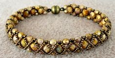 Linda's Crafty Inspirations: Bracelet of the Day: Hugs & Kisses - Smoky Topaz Uses Renaissance Pattern Not sure I'll have the patience to do this, but at least it's here if I want to try. Beaded Braclets, Beaded Bracelet Patterns, Seed Bead Bracelets, Seed Bead Jewelry, Bead Jewellery, Jewelry Patterns, Beaded Jewelry, Jewelery, Jewelry Bracelets