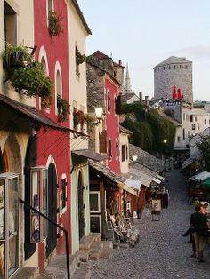 A street of shops in Mostar, Bosnia and Herzegovina. Mostar was the most heavily bombed of any Bosnian city during the war in Bosnia and Herzegovina following the breakup of Yugoslavia. At the beginning of the war, air strikes destroyed many important buildings and structures, including the cultural and spiritual icon: The Old Bridge (Stari Most).