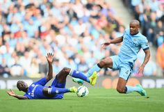Ramires of Chelsea battles for the ball with Vincent Kompany of Manchester City during the Barclays Premier League match between Manchester City and Chelsea at Etihad Stadium on September 21, 2014 in Manchester, England.