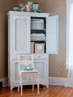 Linen Storage Solutions - Towels and linens stack neatly in this pastel armoire. Matching bins house other bedroom accessories, such as decorative pillows and bedding. For a touch of elegance, fold a pillowcase over the edge of a bin to display its decorative lace trim. Store extra blankets out of sight in the bottom cabinet. Use the top of the armoire to display colored vases.