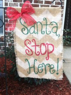 Christmas garden flag white chevron with red and green writing topped with a red mesh bow! on Etsy, $15.00