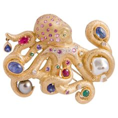 Circa 1980's  A beautifully crafted and truly unique brooch depicting an octopus encrusted with yellow and white diamonds, rubies, all colors of sapphires and South Sea and Tahitian pearls.