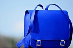 This funny blue backpack will give your outfit the perfect pop of color! Crazy Blue Backpack by Laura Olaru available at Band of Creators Designers' Store.