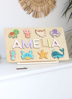 Sea animals theme Baby Gift - Ocean Birthday - Girl Name Puzzle - Gift for Godchild - New Baby Boy - Baptism Gift - Woodily Toys / ss24. Our Personalized ocean themed name puzzles are designed to fuel imagination, inspire exploration and encourage the natural curiosity that leads to a lifetime of learning. #woodtoy #namepuzzle