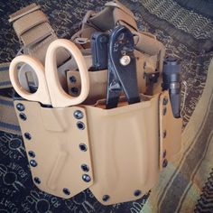I built this about a year ago when I was still in the Army doing large scale demo ops. My carriers for handy tools attached to a Blackhawk drop leg panel. This turned out great and was handy to have. Edc Tactical, Tactical Equipment, Tactical Survival, Survival Gear, Cool Tools, Handy Tools, Battle Belt, Tac Gear, Chest Rig