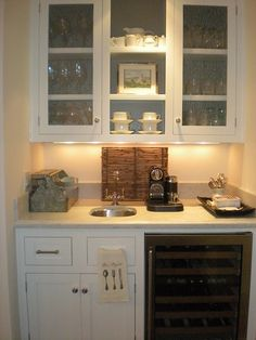 kitchen beverage center with filtered water, hot water dispenser & wine fridge