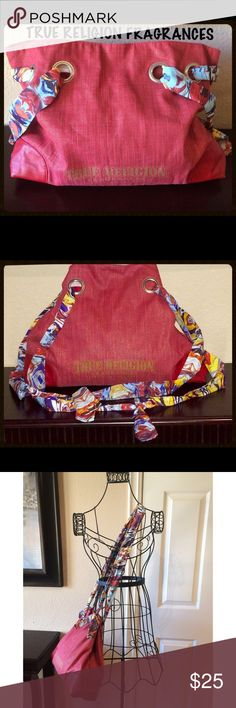 """TRUE RELIGION Fragrances Bag w/Scarf Straps GUC TRUE RELIGION Fragrances canvas boho """"shopper"""" bag w/multi-color abstract scarf straps. Faux leather patches on bottom corners.  Main color of bag is red mixed w/gold shimmer. Writing on front of bag is a gold tone.  Color may slightly vary in pics compared 2 actual due 2 lighting. Pre-owned, yet n great condition. All manmade material. Exterior/interior show little 2 no wear. May have been used a 1-2x. Interior-1 zipper compartment. Magnetic…"""