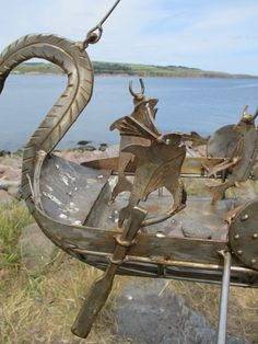 A Viking helmsfish steers the ship - fishcrewed ships on Stonehaven's boardwalk