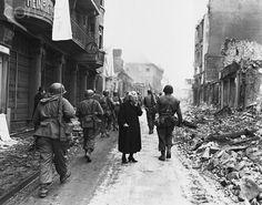 German Woman Surveying Damage, Jerry Rutberg, 1945.