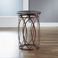 Inspire your living space with this round side table by InnerSpace, featuring an…