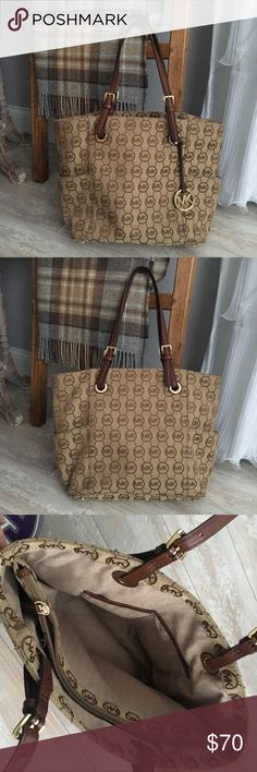 Michael Kors Tote Bag Authentic Michael Kors medium brown/tan signature tote bag. Used a couple of times, but in great condition! Michael Kors Bags Totes