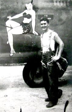 "Carl Driver of Punta Gorda, Fla. was a tailgunner on a B-24 ""Liberator"" in World War II. He stands beside the nose art on his bomber ""Passionate Witch."" Driver flew in the 13th Air Force in the Pacific. Photo provided"