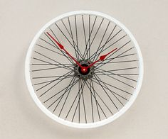 This clock was made from a recycled aluminum Mongoose bike wheel. The wheel mounts directly to the wall through the hub using a hollow wall anchor and
