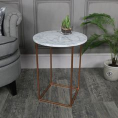 White Marble Topped Side Table #homedecor #interiordesign #marble #gold #interiorinspiration #passion4interiors #tusticinterior #rusticdecor #vintagedecor #vintage #shabbychic #luxuryhome #luxurydecor #myinterior #interiors #englihshome #vintagehome #darkdecor #homedecor #homedesign #homedecorideas #homedecorations #industrialinterior #rustic #home #love #inspiration #instagram #instahome #copper #marble #home #quirky #cool