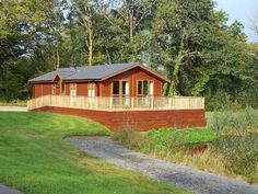 This is Oak Lodge near Narberth in Pembrokeshire, South Wales. Sleeps four people, private hot tub, fishing & golf. Stunning 30 acres of woodlands, parkland & gardens. Weekly prices from £500.