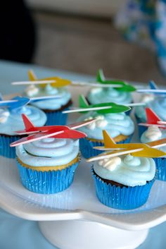 Airplane Birthday cupcakes.  love these planes for toppers