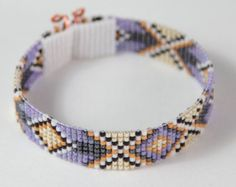 This 7 long Fire Dance Bead Loom bracelet was inspired by the amazing patterns I see and love around me here in Albuquerque, New Mexico. As with all my pieces, Ive created it on a bead loom with great care and attention to detail. IMPORTANT NOTE: This bracelet measures approximately 7 long. Please measure your wrist carefully before order placement, to ensure a proper fit. If 7 is not the correct size for you, please contact me for options.  The beads used in this piece are my favorite…