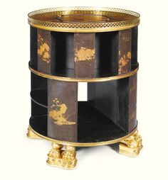 A Regency black lacquered and giltwood drum shaped bookcase, early 19thC, 2'7''x2'2'', 64K gbp