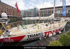 Download this stock image: Clipper 70 yacht moored in St Katharine Docks Marina, London UK - E4XXX4 from Alamy's library of millions of high resolution stock photos, Stock Photo, illustrations and vectors.